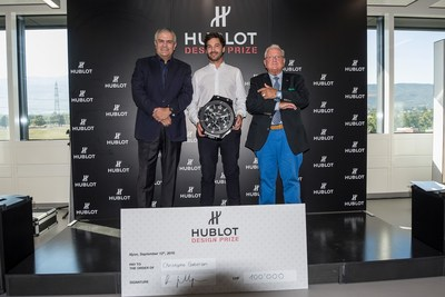 Christophe Guberan receives the prize from Ricardo Guadalupe - Hublot CEO - and Pierre Keller - President of the Jury (PRNewsFoto/Hublot SA)
