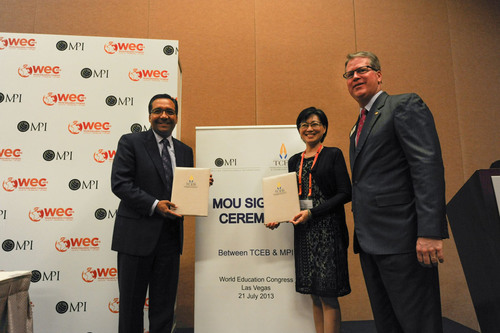 Mr. Paul Van Deventer, president and CEO of MPI (Right) and Mrs. Nichapa Yoswee, Director of MICE Capabilities Department of TCEB (Centre).  (PRNewsFoto/Thailand Convention & Exhibition Bureau)