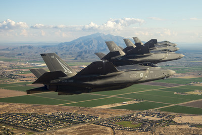 Four F-35 Lighting II aircraft fly over Luke Air Force Base, Arizona. The F-35 fleet recently surpassed 50,000 flight hours.