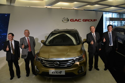 GAC Motor executives stand around the company's GS4 SUV that made its world debut at the 2015 North American International Auto Show.