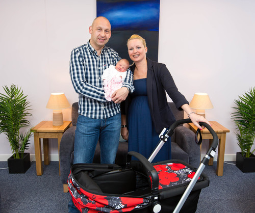 Proud parents Susan and David with Baby Eva named after the IVF test Eeva(TM) used at GCRM (PRNewsFoto/GCRM)
