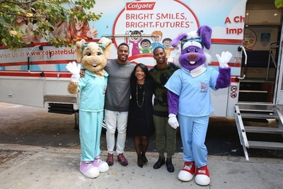 New York Giants  Rashad Jennings (2nd left) and Victor Cruz (2nd right) join Dr. Marsha Butler (center), Vice President, Global Oral Health, Colgate-Palmolive Company, and Colgate mascots, Dr. Brushwell and Dr. Rabbit, in front of a Bright Smiles, Bright Futures (BSBF) mobile dental van during BSBF's 25th Anniversary celebration in New York City. (Mark Von Holden/AP Images for Colgate Bright Smiles, Bright Futures)