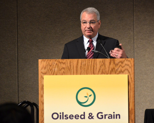 "Keynote speaker at the 2013 Oilseed & Grain Trade Summit, Carl Casale, CEO of CHS, addresses attendees during his presentation entitled, ""Staying Relevant in a Rapidly Changing World.""  (PRNewsFoto/HighQuest Partners)"