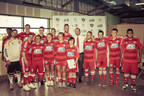 """The fifteen excited players from the 2015 FC Dallas Special Olympics Team supported by Globe Life pose with FC Dallas President Dan Hunt."" ""Image courtesy of FC Dallas"""