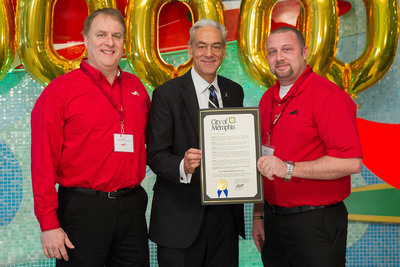 """Richard Shadyac Jr., center, CEO of ALSAC/St. Jude Children's Research Hospital, shares a proclamation by Memphis Mayor AC Wharton declaring Thursday, Nov. 14, """"Chili's More Hope Day"""" in the city with Eric Bush, left, and Jay Michalec. Bush is manager of the Wolfchase Chili's Grill and Bar in Memphis, and Michalec is Chili's Memphis-area director. The celebration recognized Chili's Grill and Bar's fulfillment of a $50-million fundraising pledge.  (PRNewsFoto/St. Jude Children's Research Hospital)"""