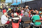 Guests enjoy a Thanksgiving meal at the Ventura County Rescue Mission's annual holiday feast.