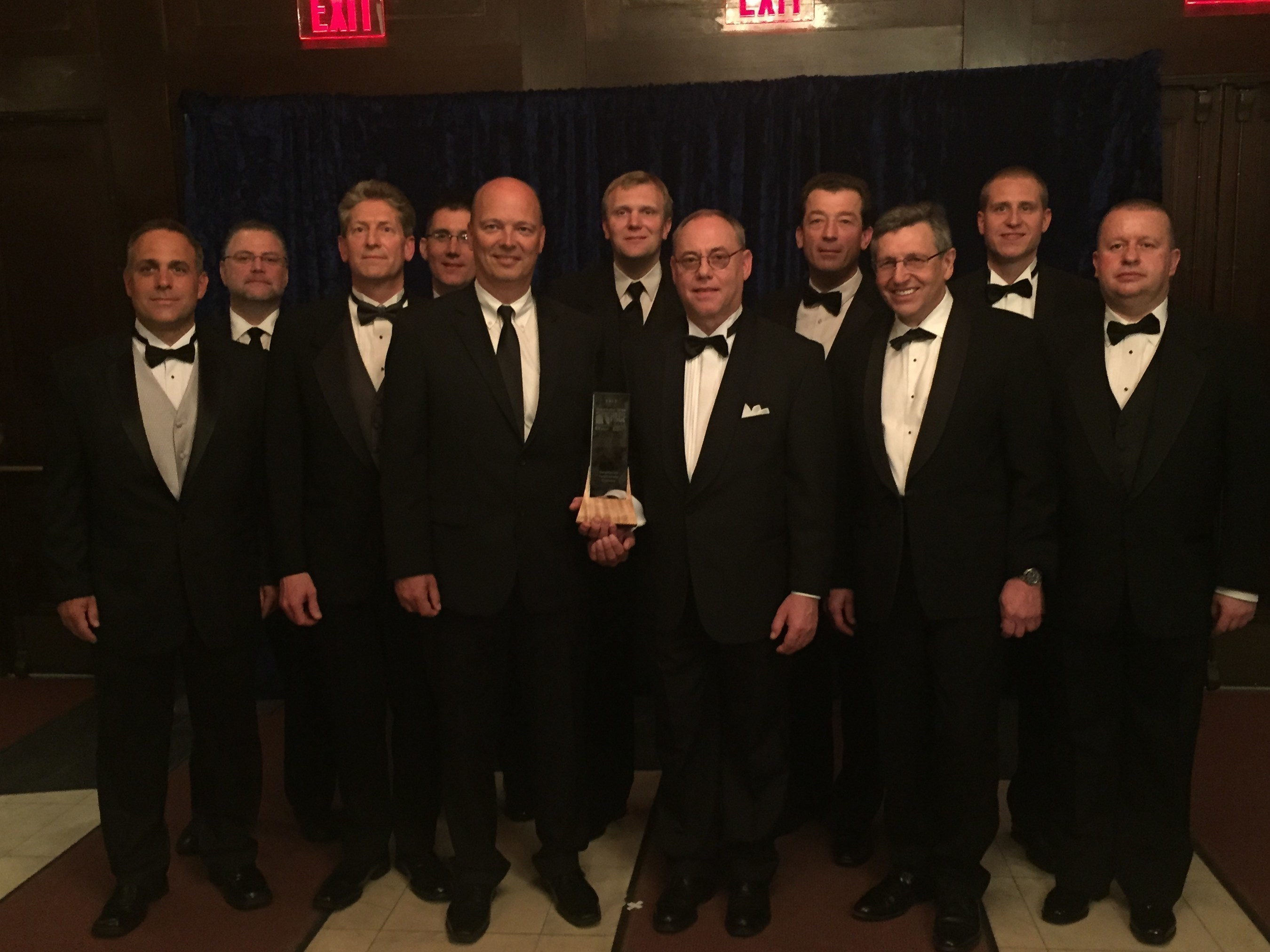 BorgWarner received a 2015 Automotive News PACE Award for its first-to-market front cross differential (FXD) technology, an innovation that provides automakers with a cost-effective and fuel-efficient alternative to all-wheel drive (AWD) systems. BorgWarner employees were joined by Dr. Burkhard Huhnke, General Manager R&D - Product Engineering, Volkswagen Group of America (left of award).