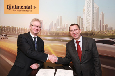 Bruno Bourguet, Senior Vice President, Sales & Business Development, HERE (right), and Helmut Matschi, Member of the Executive Board Continental, with the joint agreement for enhanced future collaboration. (PRNewsFoto/Continental) (PRNewsFoto/CONTINENTAL)