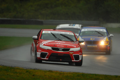 Kia Racing wraps up the 2012 Continental Tire Sports Car Challenge season with thrilling second-place finish at Lime Rock Park.  (PRNewsFoto/Kia Racing)