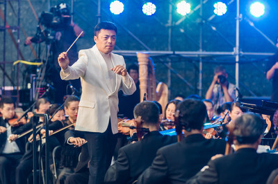 The violin virtuoso and conductor, Chai Liang, conducting the spring concert