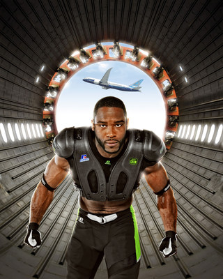 Pictured here, Russell Athletic brand ambassador and pro football wide receiver Pierre Garcon wears the CarbonTek shoulder pad system, with an exosketon made of 787 carbon fiber. He is shown inside a Boeing 787 Dreamliner carbon composite fuselage.