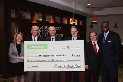 Check presentation at the Minnesota Dental Association: Left to right, Ann Johnson, Executive Director, Delta Dental of Minnesota Foundation; Joseph Lally, V.P. Government Relations & Compliance, Delta Dental of Minnesota; Steve Litton, DDS, President, Minnesota Dental Foundation; Alejandro Aguirre, DDS, Chair, Minnesota Mission of Mercy; Michael Zakula, DDS, MDA President; Rodney Young, CEO and President, Delta Dental of Minnesota and Chair, Delta Dental of Minnesota Foundation.  (PRNewsFoto/Minnesota Dental Association)