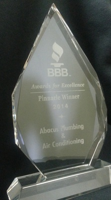 Abacus Plumbing & Air Conditioning recognized with 2014 Pinnacle Award at the Better Business Bureau Awards for Excellence luncheon held Wednesday, May 7 at the Westin Galleria. (PRNewsFoto/Abacus Plumbing & Air Conditioni)