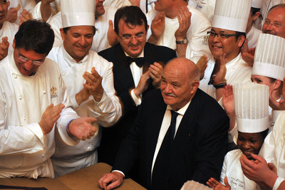 Jaume Tapies, Chairman of the Board of Relais & Chateaux (center, left), and renowned restaurateur Pierre Troisgros (center, right), are surrounded by Grands Chefs at the Diner des Grands Chefs at Chateau de Versailles on April 6.  The 60 Grands Chefs prepared dinner for 650 guests in celebration of the inscription of the Gastronomic Meal of the French in UNESCO's List of Intangible Cultural Heritage of Humanity.  Proceeds will fund the creation of the Cite de la Gastronomie.  (PRNewsFoto/Relais & Chateaux, Francois Durand/Getty Images)