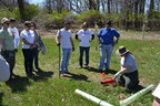 CSL Behring employees receive instructions from a Valley Forge National Park ranger before digging in and planting 100 saplings donated to the park by CSL Behring to mark the company's 100th Anniversary. The trees included five different species native to the area.