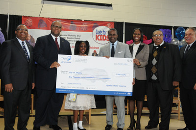 From Left to Right: Zafar Brooks, Director, General Affairs Corporate Social Responsibility & Diversity Inclusion, Byron Amos, APS Board Member, Iysis Jones, 4th Grade Student, Kasim Reed, Mayor of Atlanta, Jami Pettway, Principal, Bethune Elementary School, Ivory Young, City of Atlanta Council Member, and Eugene Duffy, NAACP Board of Trustees Chairman stand alongside a check for 1,000 coats donated from Hyundai Motor America to underprivileged children in the city of Atlanta at an event at Bethune Elementary School on Tuesday, March 5, 2013.  (PRNewsFoto/Hyundai Motor America)