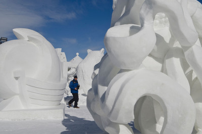 A spectator walks through the outdoor art gallery created by the International Snow Sculpture Championships in Breckenridge, Colo. The 2013 competition will take place Jan. 22 - Feb. 3. (Carl Scofield / GoBreck).