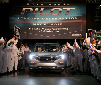 Associates at Honda Manufacturing of Alabama celebrate the production of the all-new 2016 Honda Pilot Thursday at the plant in Lincoln, Alabama.
