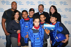 Former Yankees All-Star Bernie Williams and Baseball Hall of Famer Juan Marichal join Time Warner Cable in the donation of baseball equipment to the Inwood Little League of New York City in celebration of the Caribbean World Series.  (PRNewsFoto/Time Warner Cable)