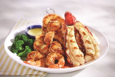 The Ultimate Wood-Grilled Feast features a Maine lobster tail and two skewers of sweet, bourbon-glazed shrimp and scallops- all prepared on an oak wood-fire grill and served over a sweet and savory tomato jam.