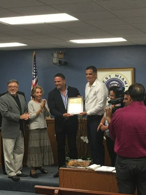 Accepting appreciation award from the City of West Miami Police Department
