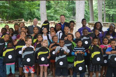 All campers at Hartford's Camp Courant received a backpack filled with back-to-school supplies from CHET and State Treasurer Denise L. Nappier. A total of 1,529 backpacks are being distributed across Connecticut as part of the CHET Backpack Donation Program. Pictured from left to right, standing in back are: Lindy Lee Gold, Development Specialist for DECD; Janice Gruendel, Deputy Commissioner for Operations for DCF; Kevin Lembo , State Comptroller; Josh Reese ,Camp Courant Executive Director and State Treasurer Denise L. Nappier. (PRNewsFoto/Connecticut Higher Education Trust) (PRNewsFoto/CHET)