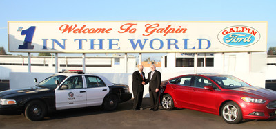 Galpin Ford and LoJack Corporation entered into an agreement to install the LoJack Stolen Vehicle Recovery System on Galpin Ford's fleet of vehicles.  Pictured is Bert Boeckmann (left), owner of Galpin Motors, Inc., and Randy Ortiz (right), CEO and President of LoJack Corporation.  Galpin Ford has been the world's largest Ford dealership for 22 consecutive years and this marks the largest agreement of its kind that LoJack Corporation has established with a single dealership.  (PRNewsFoto/LoJack Corporation)