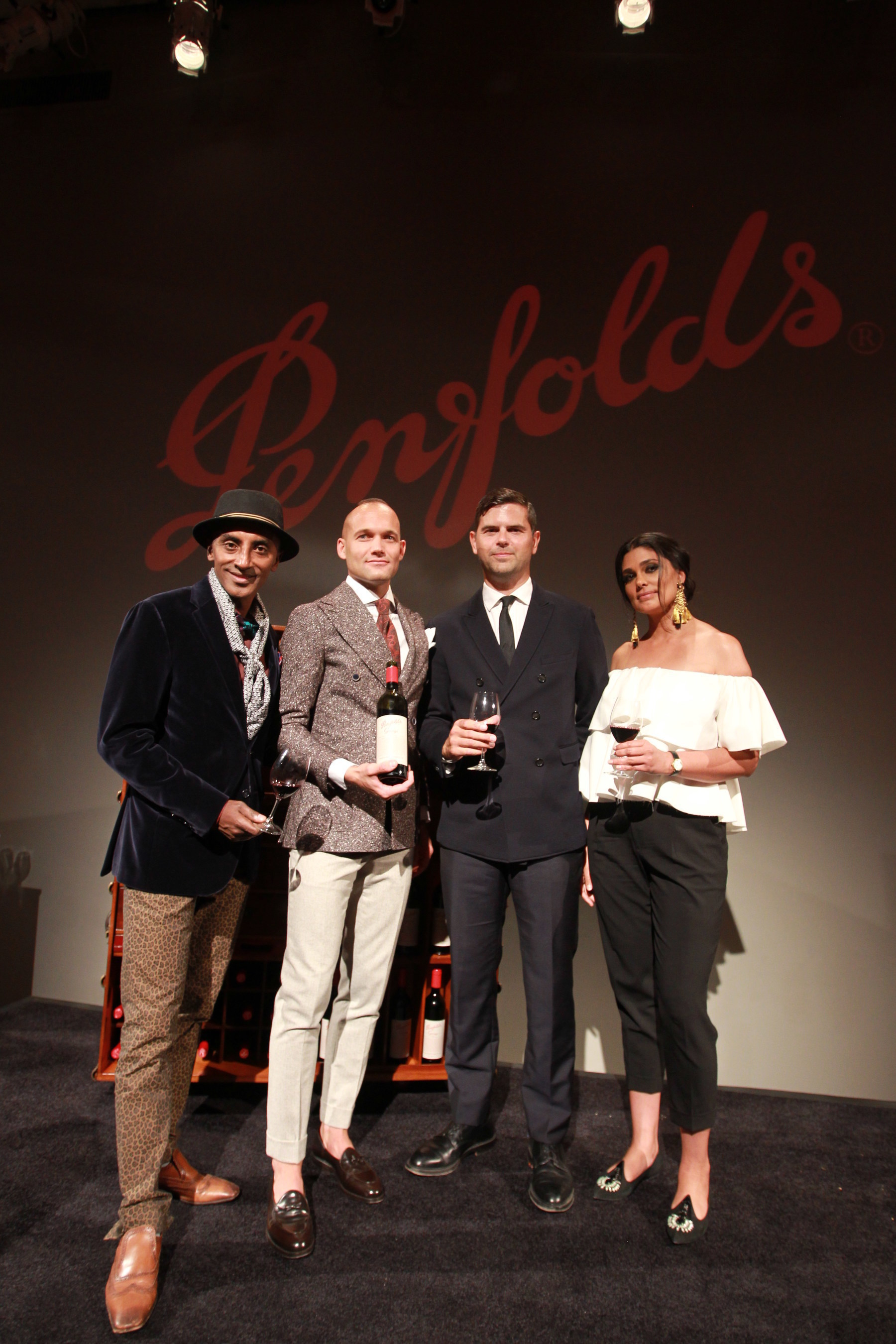 Kyle Ridington from Piora Restaurant in New York City, second from left, was crowned Penfolds & GQ Magazine's Best Dressed Sommelier by celebrity chef and style guru Marcus Samuelsson, GQ Executive Stylist Brett Fahlgren, and designer Rachel Roy. Ridington celebrated his win by opening a bottle of the acclaimed Penfolds 2011 Grange at The Penfolds House inside Stephan Weiss Studios in New York City. (Photo by Donald Traill/Invision for Penfolds Wine/AP Images)