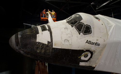 Space Shuttle Atlantis Emerges from Protective Shrink Wrap as Work Continues on New Attraction at