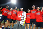 "Following their 25-12 victory, the Washington Kastles donned ""34 Straight"" T-shirts and raised jerseys symbolic of the new and old records for the longest winning streak by a major U.S. pro sports team. From left to right are Leander Paes, Anastasia Rodionova, Bobby Reynolds, Owner Mark Ein, Martina Hingis, Kevin Anderson and Coach Murphy Jensen. (PRNewsFoto/Washington Kastles, Kevin Koski)"