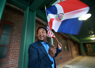 Dominican-born all-star Pedro Martinez proudly waves his home country's flag. Martinez, a three-time Cy Young Award winner and eight-time All-Star pitcher with the Los Angeles Dodgers, Montreal Expos, Boston Red Sox, New York Mets and Philadelphia Phillies, will join Craig Biggio, Randy Johnson and John Smoltz as the four newest players to be inducted to the National Baseball Hall of Fame and Museum July 24-27.