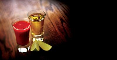 CAZADORES Anejo accompanied by Sangrita (tomato juice, lime juice, and chili sauce) | Tequila CAZADORES Anejo en una copa tequilera acompanado por Sangrita, el tradicional complemento mexicano del tequila.  (PRNewsFoto/Bacardi U.S.A., Inc.)