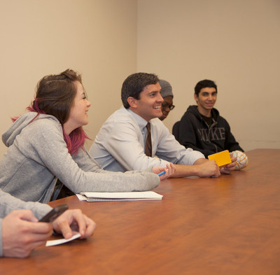 Rye Barcott (middle) meeting with BHCC students on November 6, 2014 at Bunker Hill Community College.