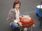 Lovely Lynnae Derry with the ultimate man gift for this holiday season.  A football shaped charcoal grill from Hot Sports Grills.  www.hotsportsgrills.com.  (PRNewsFoto/Hot Sports Grills)
