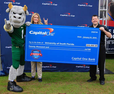 University of South Florida mascot Rocky the Bull is named the 2013 Capital One Mascot of the Year at the Capital One Bowl game in Orlando, Fla. on January 1, 2014.  Rocky the Bull and Marcy Lanoue (from left), USF Director of Development, receive a $20,000 check to be used toward the school's mascot program from Marc Mentry (right), Senior Vice President at Capital One.  (PRNewsFoto/Capital One)