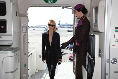 "Supermodel Amber Valletta welcomed by Etihad Airways cabin onboard the airline's ""NYFW: The Shows""-branded aircraft livery by cabin crew."