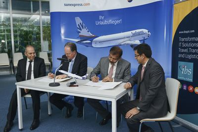 IBS Group Executive Chairman V K Mathews and SunExpress Managing Director Jaan Albrecht signing the contract