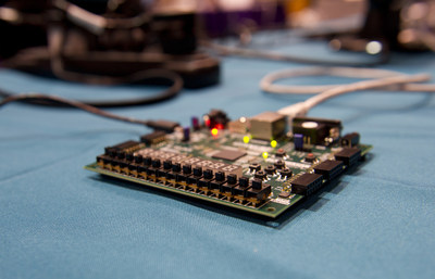 Finalists in the 2015 CSAW Embedded Security Contest brought their research as well as programmable computer boards to see if they could hack into an example of what may well become the next generation of voting systems, protected by homomorphic encryption.