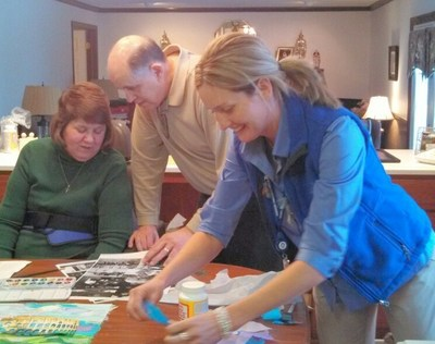 Michele and her husband, Joe, work on a collage documenting an anniversary trip to Italy with the guidance of Hospice of the Western Reserve art therapist Holly Queen.