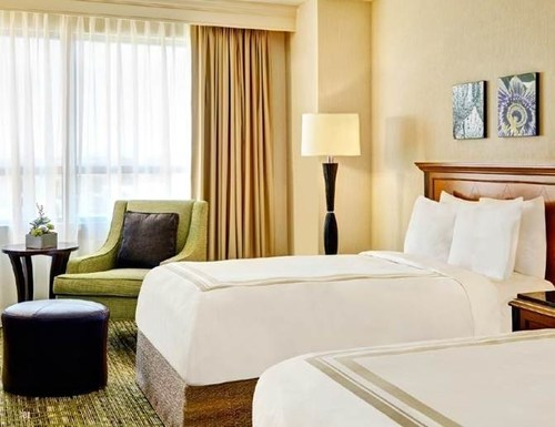 Fremont Marriott Exterior and Fremont Marriott Guest Room (PRNewsFoto/Ashford Hospitality Trust, Inc.)