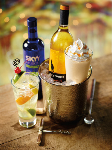 Developed by Red Robin's master mixologist Donna Ruch, the new Mango Moscato Wine Shake will be available through Sept. 1 exclusively at Red Robin(R) restaurants nationwide. Guests 21-and-over will enjoy this deliciously daring combination of Alice White(R) Moscato and SKYY Infusions(R) Moscato vodka with mango puree and creamy vanilla soft serve.  (PRNewsFoto/Red Robin Gourmet Burgers, Inc.)