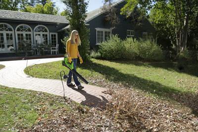Peyton Lambton using the Greenworks 40V Leaf Blower