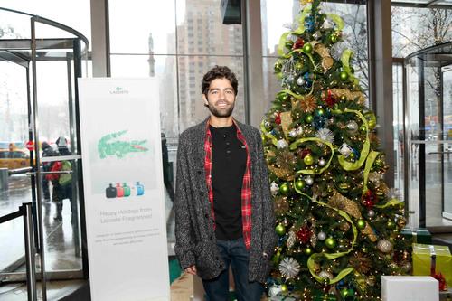 Adrian Grenier Helps Celebrate the Holidays with LACOSTE Fragrances. (PRNewsFoto/LACOSTE Fragrances) ...