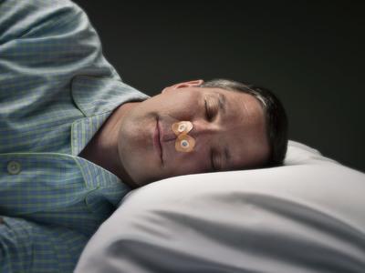 Man sleeping with Provent(R) Sleep Apnea Therapy. (PRNewsFoto/Ventus Medical, RJ Muna)