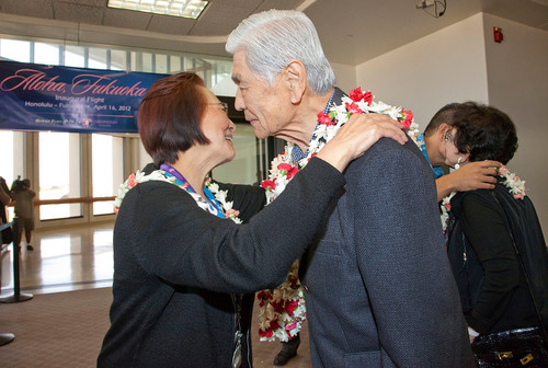 Joanne Trask of Hawaiian Airlines presents former Hawaii Governor George Ariyoshi with a fresh flower lei before he boards today's inaugural flight to Fukuoka. In 1981, Governor Ariyoshi, whose father came to Honolulu from Fukuoka, was instrumental in establishing a Sister-State relationship between Fukuoka and Hawaii. (Photo Credit: Rae Huo).  (PRNewsFoto/Hawaiian Airlines, Rae Huo)