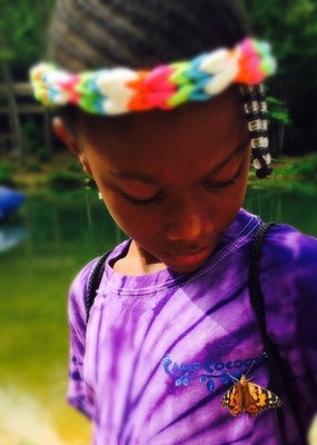 From mourning to healing - children release butterflies to bring Camp Cocoon to a close.