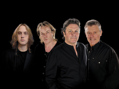 ASIA returns with new studio album, Gravitas, to be released March 21 (Europe) and March 25th (North America). L to R: Sam Coulson, Geoff Downes, John Wetton, and Carl Palmer.  The band will be touring in the second half of 2014.