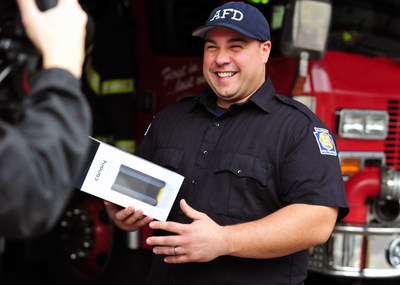 Firefighter Anthony Rosanio with the Allentown Fire Department receives a Canary home monitoring device at the national kick-off for Protect the Protectors, a joint campaign between State Farm and Canary.