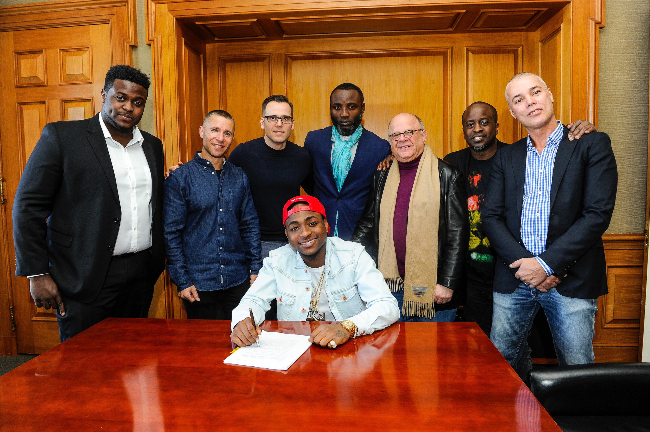 Sony Music Entertainment Sign Nigerian Musician Davido - Pictured (L to R): Adewale Adeleke, Chairman, HKN Records; Adam Granite, President, Northern & Eastern Europe and Africa, Sony Music International; Dusko Justic, Vice President, International Marketing, Sony Music International; Kamal Ajiboye, Manager for Davido; Joel Katz, Chairman Media & Entertainment, Greenberg Traurig; Efe Ogbeni, Executive Producer / Head A&R, Regime Music Societe; Sean Watson, Managing Director, Sony Music Africa...