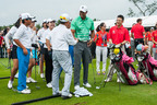 Tiger passes on tips to Juniors in China at Mission Hills Haikou.  (PRNewsFoto/Mission Hills China)